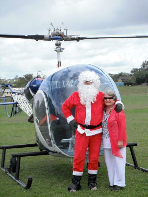 Santa delivering presents by helicopter